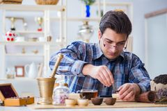 The professional tea expert trying new brews. Professional tea expert trying new brews Royalty Free Stock Image
