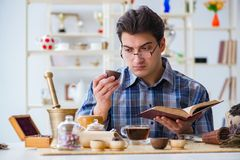 The professional tea expert trying new brews. Professional tea expert trying new brews Stock Image