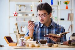 The professional tea expert trying new brews Stock Photo