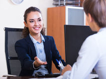 Professional teaching new employee Royalty Free Stock Photo