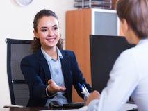 Professional teaching new employee Royalty Free Stock Photo