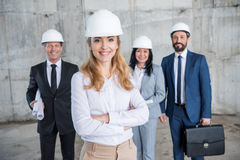 Professional team of architects in helmets standing together Royalty Free Stock Photography