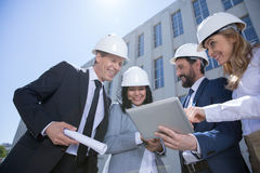 Professional team of architects using digital tablet while working together Stock Images