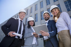 Professional team of architects using digital tablet while working together Royalty Free Stock Photography