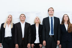 Professional team looking up Stock Photo