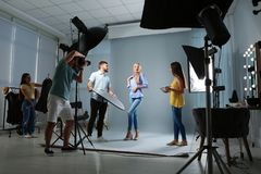Professional team working with model. In photo studio royalty free stock image