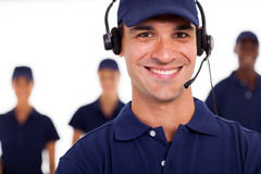 Professional IT technician. With headphones on the call stock photo