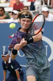 Professional tennis player Andrey Rublev of Russia in action during his US Open 2017 second round match. NEW YORK - AUGUST 31, 2017: Professional tennis player Royalty Free Stock Photo
