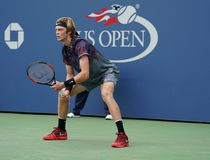 Professional tennis player Andrey Rublev of Russia in action during his US Open 2017 second round match. NEW YORK - AUGUST 31, 2017: Professional tennis player Stock Images