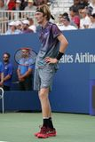 Professional tennis player Andrey Rublev of Russia in action during his US Open 2017 second round match. NEW YORK - AUGUST 31, 2017: Professional tennis player Stock Photography