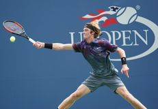 Professional tennis player Andrey Rublev of Russia in action during his US Open 2017 second round match. NEW YORK - AUGUST 31, 2017: Professional tennis player Stock Image