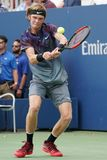 Professional tennis player Andrey Rublev of Russia in action during his US Open 2017 second round match. NEW YORK - AUGUST 31, 2017: Professional tennis player Royalty Free Stock Photos