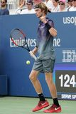 Professional tennis player Andrey Rublev of Russia in action during his US Open 2017 second round match. NEW YORK - AUGUST 31, 2017: Professional tennis player Royalty Free Stock Photography