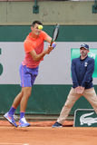Professional tennis player Bernard Tomic of Australia in action his during first round match at Roland Garros Royalty Free Stock Image