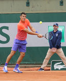 Professional tennis player Bernard Tomic of Australia in action his during first round match at Roland Garros Stock Photos