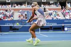 Professional tennis player Caroline Wozniacki of Denmark in action during US Open 2015 Royalty Free Stock Photo