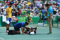 Professional tennis player Dustin Brown of Germany needs medical attention during first round match of the Rio 2016 Olympic Games Stock Images