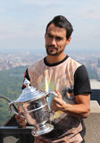 Professional tennis player Fabio Fognini of Italy posing with US Open trophy on the Top of the Rock Observation Deck Royalty Free Stock Image