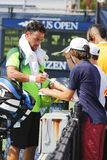 Professional tennis player Fabio Fognini signing autographs after match at US Open 2014 Royalty Free Stock Image