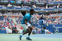 Professional tennis player Gael Monfis of France in action during his US Open 2016 quarterfinal match at National Tennis Center. NEW YORK - SEPTEMBER 6, 2016 Stock Photography