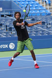 Professional tennis player Gael Monfis of France  practices for US Open 2015 Royalty Free Stock Photo