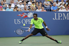 Professional tennis player Gael Monfis during US Open 2014 second round match against Jared Donaldson Stock Photos
