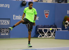 Professional tennis player Gael Monfis using the Tweener during quarterfinal match at US Open 2014 Royalty Free Stock Photos