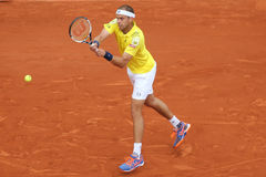 Professional tennis player Gilles Muller of Luxembourg in action during his second round match at Roland Garros Stock Images