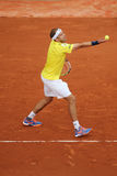 Professional tennis player Gilles Muller of Luxembourg in action during his second round match at Roland Garros Royalty Free Stock Photography