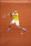 Professional tennis player Gilles Muller of Luxembourg in action during his second round match at Roland Garros Stock Photography