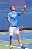 Professional tennis player Gilles Simon practices for US Open 2014 Royalty Free Stock Image