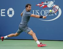 Professional tennis player Grigor Dimitrov of Bulgaria in action during his US Open 2017 second round match. NEW YORK - AUGUST 31, 2017: Professional tennis Stock Photo