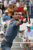 Professional tennis player Grigor Dimitrov of Bulgaria in action during his US Open 2017 second round match. NEW YORK - AUGUST 31, 2017: Professional tennis Royalty Free Stock Photos