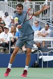 Professional tennis player Grigor Dimitrov of Bulgaria in action during his US Open 2017 second round match. NEW YORK - AUGUST 31, 2017: Professional tennis Royalty Free Stock Photography