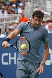 Professional tennis player Grigor Dimitrov of Bulgaria in action during his US Open 2017 second round match. NEW YORK - AUGUST 31, 2017: Professional tennis Royalty Free Stock Photo
