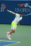 Professional tennis player Grigor Dimitrov of Bulgaria in action during US Open 2016 round three match. NEW YORK - SEPTEMBER 5, 2016: Professional tennis player Stock Photo