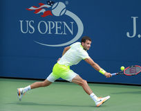 Professional tennis player Grigor Dimitrov of Bulgaria in action during US Open 2016 round three match. NEW YORK - SEPTEMBER 5, 2016: Professional tennis player Stock Images