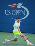 Professional tennis player Grigor Dimitrov of Bulgaria in action during US Open 2016 round three match. NEW YORK - SEPTEMBER 5, 2016: Professional tennis player Royalty Free Stock Photography