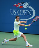Professional tennis player Grigor Dimitrov of Bulgaria in action during US Open 2016 round three match. NEW YORK - SEPTEMBER 5, 2016: Professional tennis player Stock Image