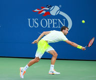 Professional tennis player Grigor Dimitrov of Bulgaria in action during US Open 2016 round three match. NEW YORK - SEPTEMBER 5, 2016: Professional tennis player Royalty Free Stock Images