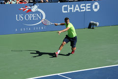 Professional tennis player Grigor Dimitrov from Bulgaria practices for US Open 2013 at Billie Jean King National Tennis Center Stock Photo
