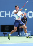 Professional tennis player Ivan Dodig during third round singles match at US Open 2013 Stock Photography