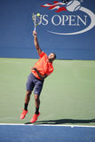 Professional tennis player Jo-Wilfried Tsonga of France in action during his round four match at US Open 2015 Royalty Free Stock Photos