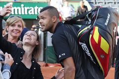 Professional tennis player Jo-Wilfried Tsonga of France taking selfie with fans after first round match at Roland Garros 2015 Stock Images