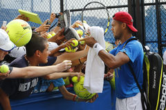 Professional tennis player Jo-Wilfried Tsonga signing autographs after practice for US Open 2014 Royalty Free Stock Photo