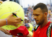 Professional tennis player Jo-Wilfried Tsonga signing autographs after  US Open 2014 match Royalty Free Stock Photos
