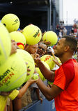 Professional tennis player Jo-Wilfried Tsonga signing autographs after US Open 2014 match. NEW YORK - AUGUST 30, 2014 Professional tennis player Jo-Wilfried Stock Images