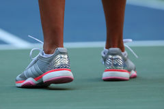 Professional tennis player Kateryna Kozlova of Ukraine wears custom Adidas by Stella McCartney tennis shoes during US Open match. NEW YORK - AUGUST 30, 2016 royalty free stock images