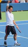 Professional tennis player Kei Nishikori celebrates victory after first round US Open 2014 match Stock Photo