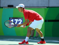 Professional tennis player Kei Nishikori of Japan in action during his men`s singles semifinal match of the Rio 2016 Olympic Games Royalty Free Stock Photo